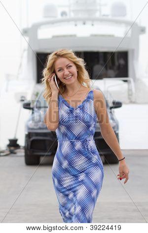 Posh Blond Girl Walks Near Yacht