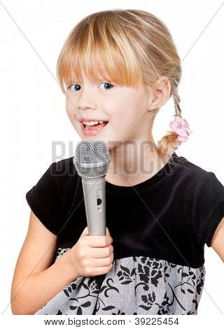 Cute little girl singing holding microphone on white background