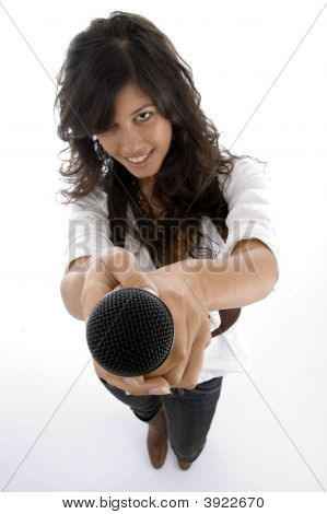 Female Singer Offering Microphone To Sing