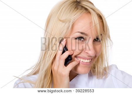 Young Smiling Beautiful Doctor Talks By Mobile Phone