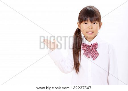 Portrait of cute schoolgirl showing