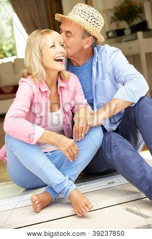 Senior Couple Sitting Outside House