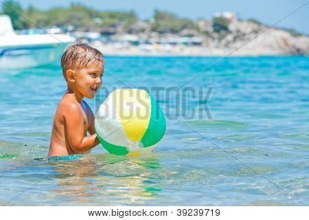 Cute boy playing in the sea