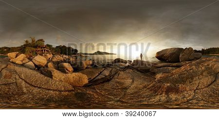 Spherical, 360 degrees panorama of a rocky coast of Andaman sea near Laem Sing beach at sunset light. Phuket, Thailand
