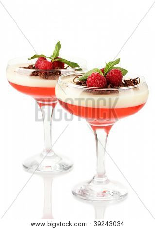 fruit jelly with chocolate and raspberries in glasses isolated on white