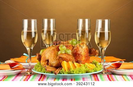 banquet table with roast chicken on brown background close-up. Thanksgiving Day