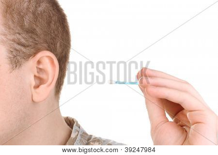 Human ear and cotton swabs close-up isolated on white