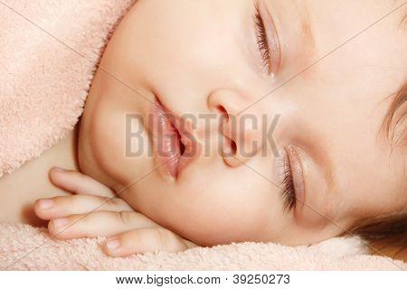 cute baby sleeping, beautiful kid's face closeup, studio shot
