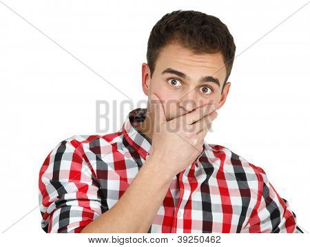 Young shocked man in checked shirt, portrait of attractive guy looking at camera with fear over white background