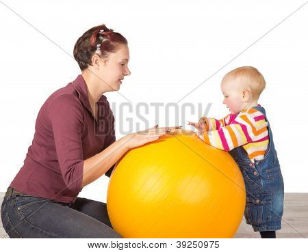 Mother And Baby With A Gym Ball