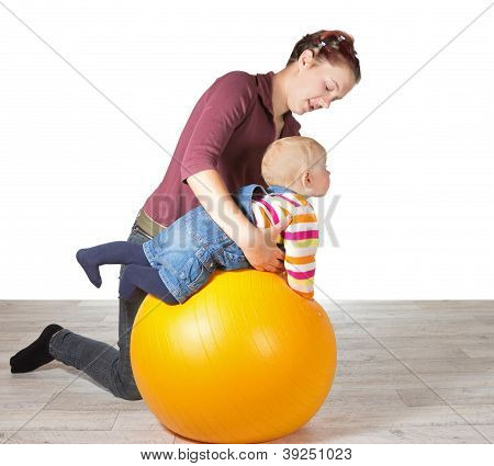 Mother Exercising Her Young Baby