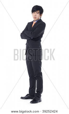 Full body young businessman with crossed arms over white background