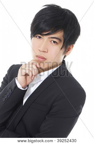 Closeup of a happy young business man looking away