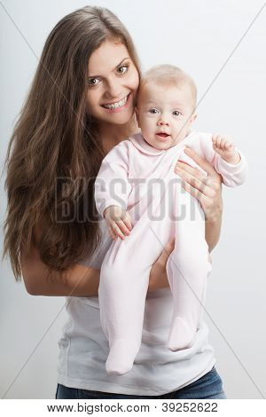 young mother  holding her baby girl on hands