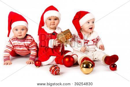 funny small kids in Santa Claus