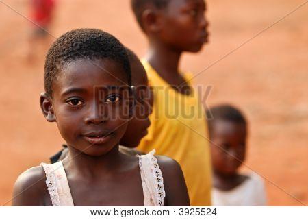 African Boy Amongst Friends