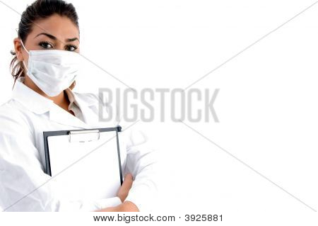 Doctor With Mask On Her Mouth And Writing Board