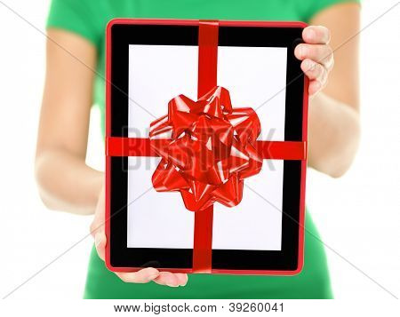 Tablet PC gift. Closeup of woman showing and giving digital tablet computer as present or christmas gift. Pure white background.