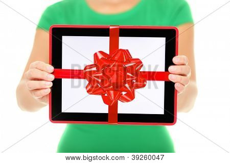 Tablet computer gift. Woman showing Digital touch screen tablet PC with gift ribbon. Closeup of woman giving tablet PC as christmas present.