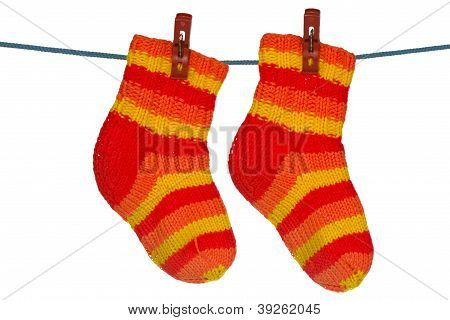 Knitted Socks Hung On The Rope