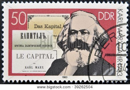 GERMANY - CIRCA 1983: A stamp printed in German Democratic Republic shows Karl Marx and the book