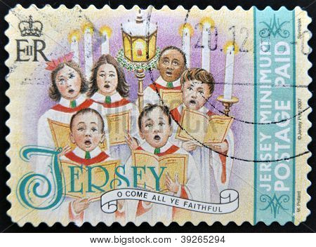 JERSEY - CIRCA 2007: A christmas stamp printed in Jersey shows children's choir singing come all ye