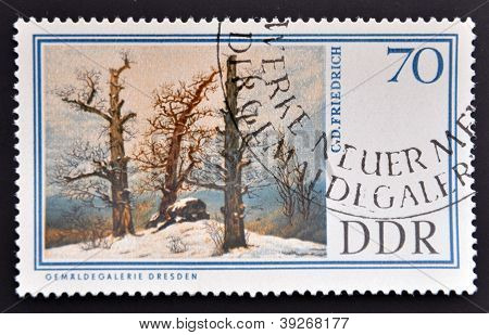 GERMANY - CIRCA 1967: A stamp printed in Easter Germany shows Dolmen in snow by Caspar David Friedri