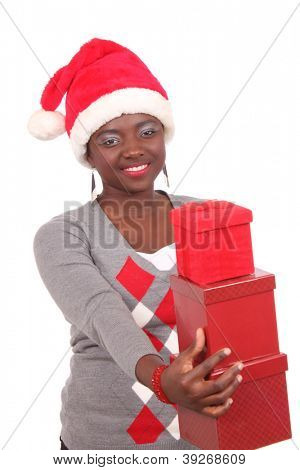 Pretty black woman dressed for Christmas and holding presents