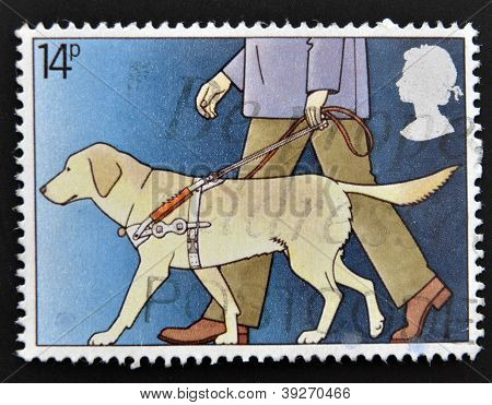 UNITED KINGDOM - CIRCA 1981: A stamp printed in Great Britain shows Blind Man with Guide Dog circa 1