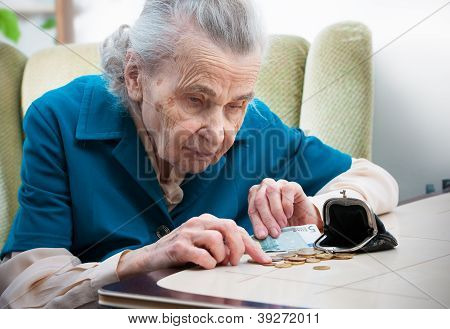 Senior Woman Counting Money