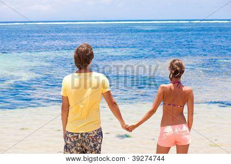 beautiful young couple looking on the horizon. honeymoom