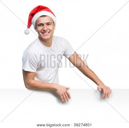 young man in a Santa Claus hat behind a white board with space for text