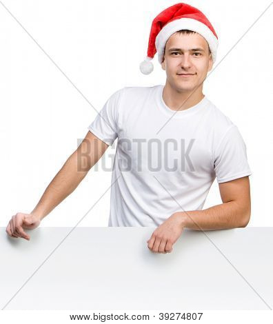 pretty young man in a Santa Claus hat behind the white board with space for text