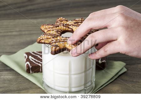 Preparing Cookie For Milk Dip