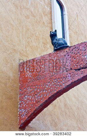 Cat Sculpture On A Concrete Beam