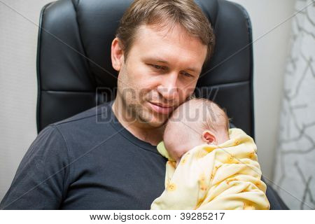 Father And Newborn Baby Daughter At Home