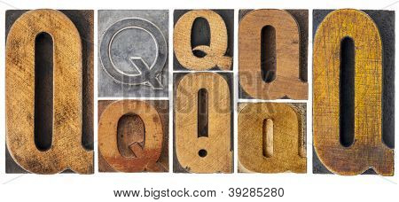 letter Q - 8 isolated vintage letterpress wood and metal type blocks with ink patina, variety of fonts