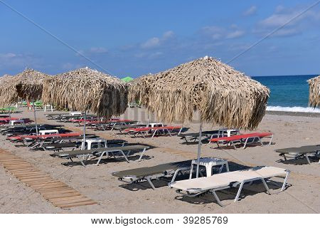Thatched Umbrellas On The Beach