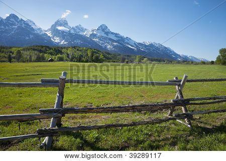 Horse Ranch Field And Fence Below Grand Teton Mountains Of Wyoming