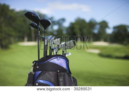Golf Bag And Clubs Against Defocused Course Background