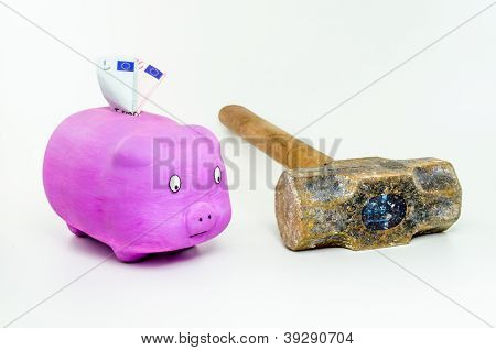 Pig with euro banknotes looking sledgehammer