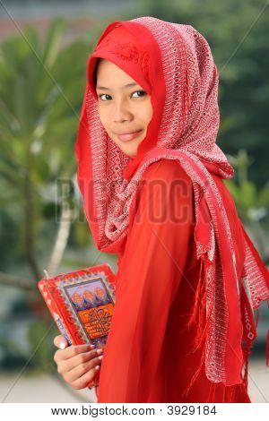 Girl Holding Koran