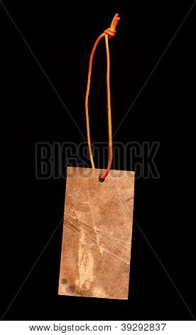 Brown paper label with orange string