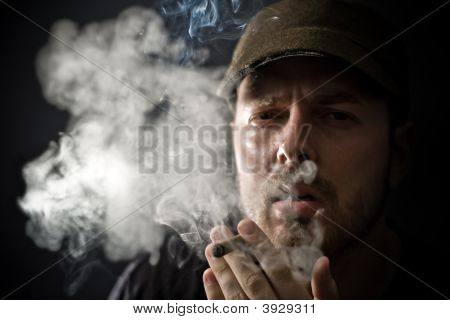 Cool Looking Guy Smoking A Cigar