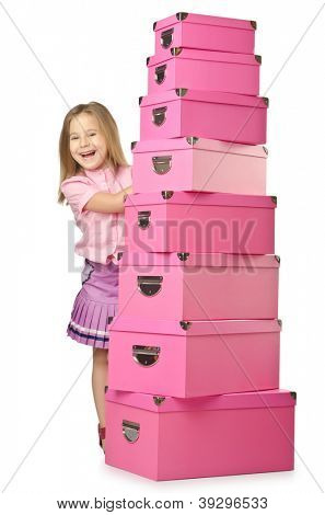 Little cute girl with lots of boxes