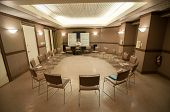 picture of aa meeting  - 12 step recovery meeting room with chairs and signs - JPG