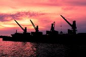 pic of dredge  - Dredge sand ship working in the sea in twilight silhouette - JPG