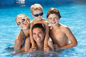 foto of mums  - Family Having Fun In Swimming Pool - JPG
