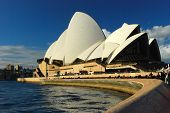 foto of musicial  - The Sydney Opera house lead into by the curved breakwater wall - JPG