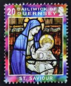 GUERNSEY - CIRCA 2005: A christmas stamp printed in Guernsey shows Virgin and Child Stained Glass Wi